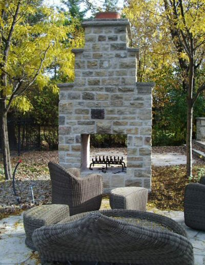Outdoor fireplace by Colin Coveny