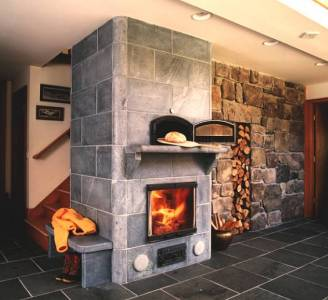 Custom soapstone masonry heater by Rod Zander