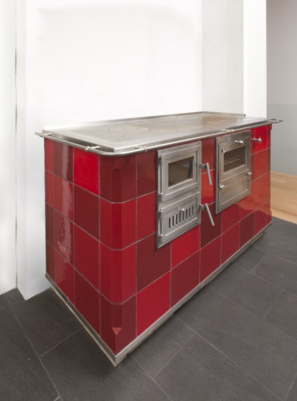 Red tile cookstove by Jessica Steinhauser